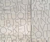 Fototapeta Salon 37 - duże szare litery na betonie, napisy, teksty