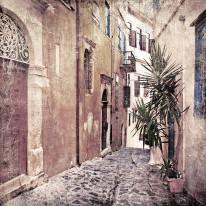 Fototapeta południowe klimaty 3 - stara kamienista uliczka, grecja, portugalia