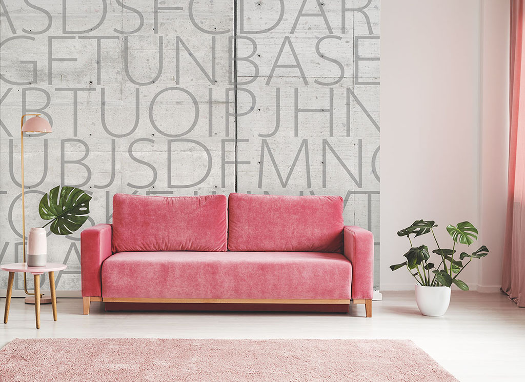 Pink couch between plant and lamp in bright living room interior